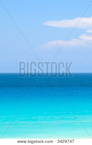 Blue And Turquoise Tropical Ocean Under Bright Blue Sky