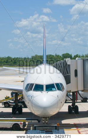 Airplane At Airport Gate, Boarding And Loading Luggage