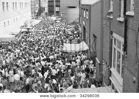 LONDON - JULY 21: The Italian street party in Warner Street, Clerkenwell on July 21, 1990 in London. The event follows the annual Catholic procession of St.Mary of Carmel which was first held in 1883.