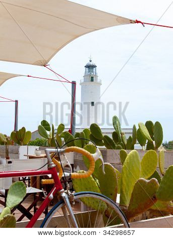 La Mola lighthouse in formentera with bicycle in foreground