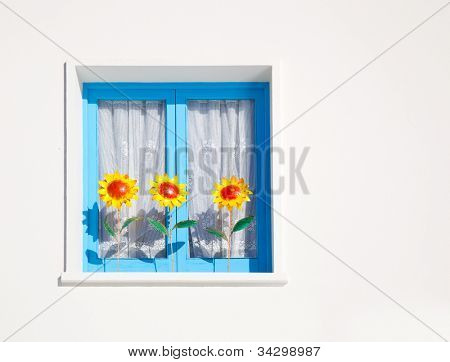 Balearic blue window with three sunflowers Mediterranean architecture detail