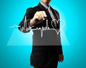 image of ecg chart  - Business man Hand drawing health - JPG
