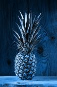 Blue Pineapple On Wooden Background. Healthy Food Ingredients, Tropical Fruits, Diet, Slimming Vegan poster