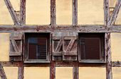 Windows and wall of old half-timbered house in Klaipeda, Lithuania.  poster