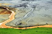 stock photo of taint  - Nature pollution of a copper mine exploitation - JPG