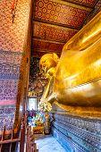 Beautiful Statue Of Reclining Golden Buddha Placed In Wat Pho Temple, Bangkok. Spiritual Place Of Bu poster