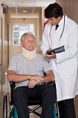 picture of neck brace  - Doctor with patient wearing neck brace in wheelchair - JPG