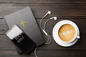 Bible, Phone, Cup Of Coffee And Earphones On Wooden Background, Flat Lay. Religious Audiobook poster