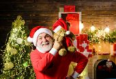 Christmas. Happy Santa Claus With Toy Teddy. Christmas Holidays. Santa Claus Man With Teddy Bear On  poster