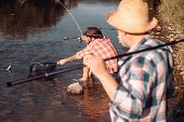 Bearded Men Catching Fish. Lear Water River. Hobby Sport Activity. Elegant Bearded Man And Brutal Hi poster