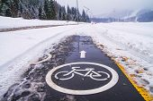 Winter Landscape - View Of The Snowy Bike Path Near The Ski Resort After Snowfall poster