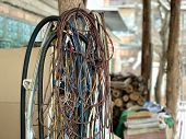 A Bunch Of Old Used Electric Wires. Wiring In The Garage From An Electrician. Multi-colored Wires In poster