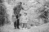Dad Teaching Little Son Care Plants. Little Helper In Garden. Make Planet Greener. Growing Plants. T poster