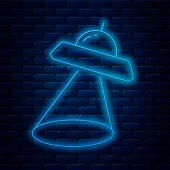 Glowing Neon Line Ufo Flying Spaceship Icon Isolated On Brick Wall Background. Flying Saucer. Alien  poster