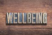 Wellbeing Word Combined On Vintage Varnished Wooden Surface poster