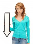 stock photo of beautiful young woman  - picture of attractive teenage girl with direction arrow sign - JPG