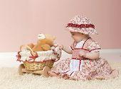 picture of cute little girl  - little child baby girl playing on the floor with toy indoors - JPG