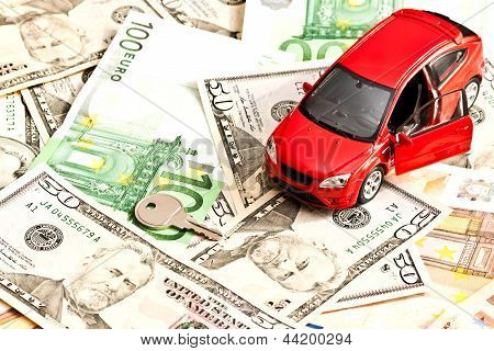 Car, Key And Money. Concept For Buying, Renting, Insurance, Fuel, Service And Repair Costs