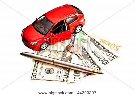 Toy Car, Key And Money Over White. Rent, Buy Or Insurance Car Concept