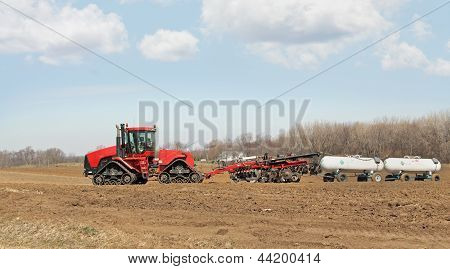 Plowing And Fertilizing