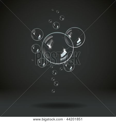 Soap bubbles on a black blue background