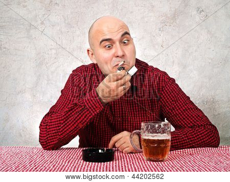 Beer Drinker Lighting Up A Cigarette
