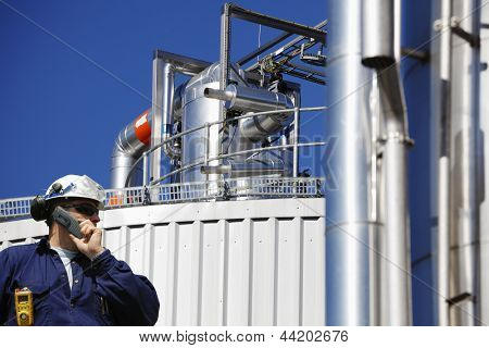 refinery worker with the main gas pump and pipelines