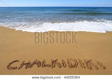 Chalkidiki written on sandy beach