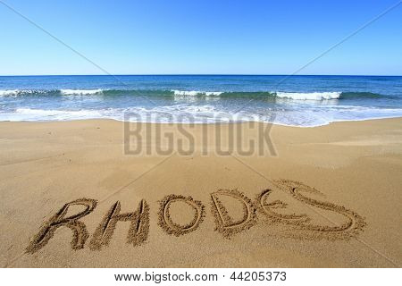 Rhodes written on sandy beach