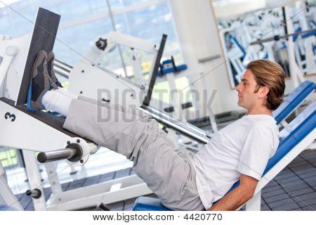 Man Exercising At The Gym