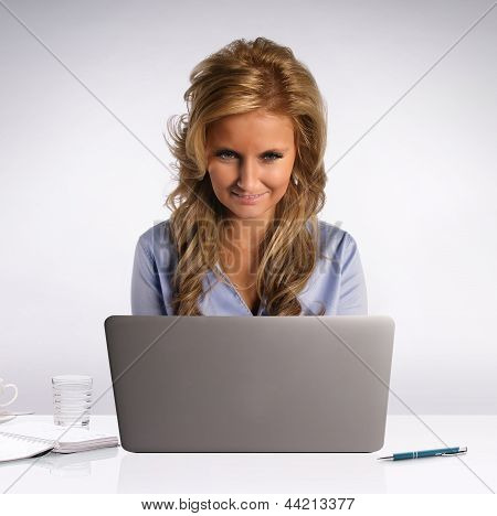 Woman Behind Laptop Computer