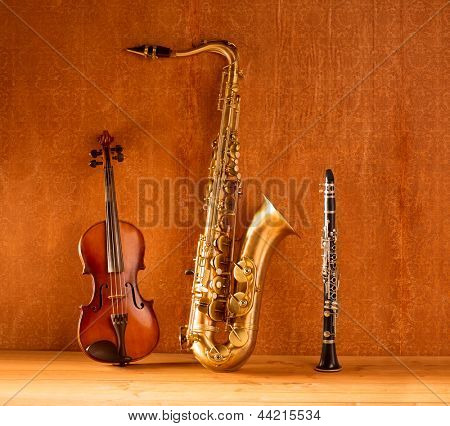 Classic music Sax tenor saxophone violin and clarinet in vintage wood background