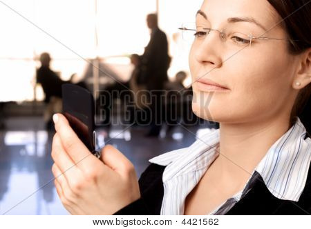 Businesswoman Dials On Cellphone