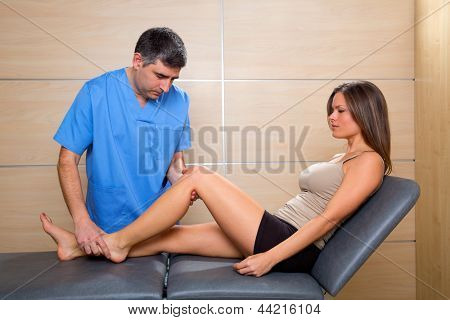 knee examination doctor therapist to woman patient in hospital