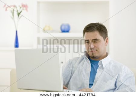 Casual Man Working At Home