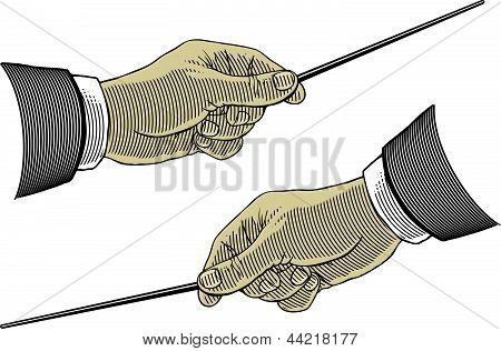 Hand holding a pointing stick