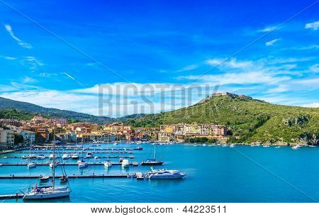 Porto Ercole Village And Harbor In A Sea Bay. Aerial View, Argentario, Tuscany, Italy