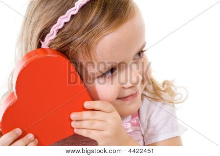 Little Girl Checking A Present