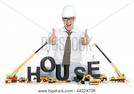 Build up a house concept: Overjoyed engineer building the word house along with construction machines, isolated on white background.