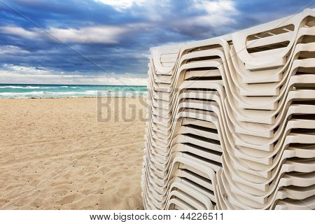 White trestle beds on the beach