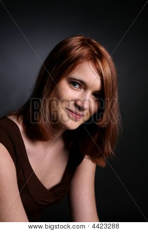 Head And Shoulders Portrait Of Pretty Auburn Haired Teen