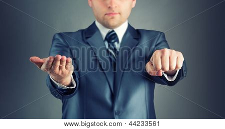 Businessman with guess hand signs