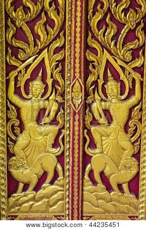 Ornament Wooden Door Of Thai Temple In Chiangmai, Thailand