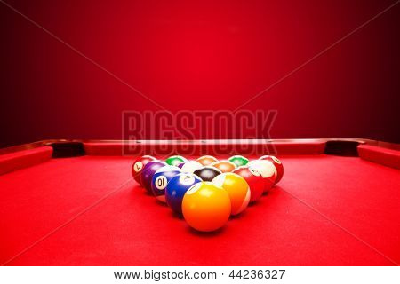 Billards pool game. Color balls in triangle. Red cloth table