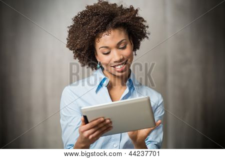 Portrait of a Successful Business woman Using Digital Tablet