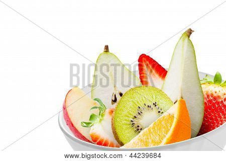 Fresh Fruits In A White Bowl Isolated