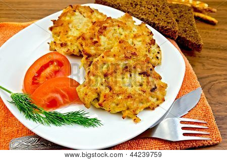 Fritters Chicken With Vegetables And Bread On A Board