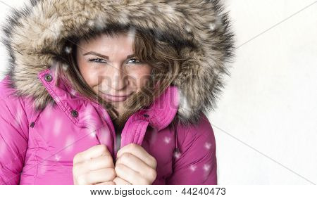 Young hispanic woman all bundled up in a snow coat. Copy Space on right.