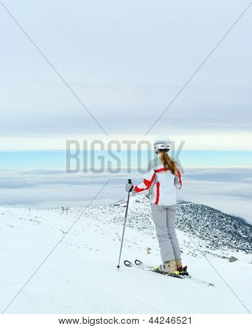 Skier Admire On Beautiful View From Top Of Mountain
