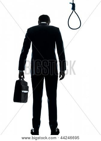 one caucasian business man  rear view standing in front of hangman's noose in silhouette studio isolated on white background